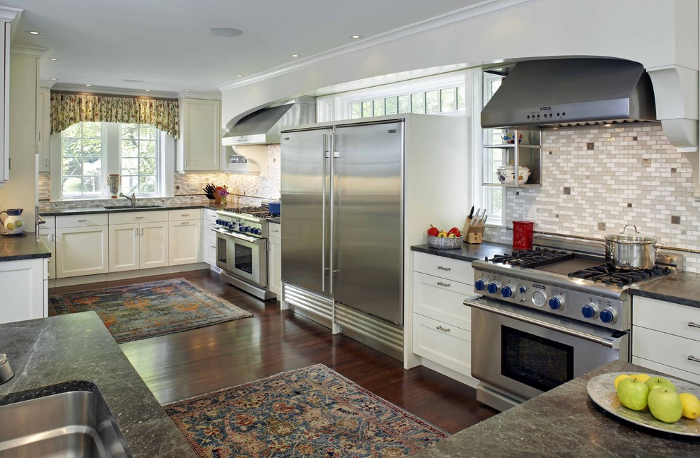 Inspiration for a timeless u-shaped kitchen remodel in Boston with soapstone countertops, stainless steel appliances, white cabinets and multicolored backsplash