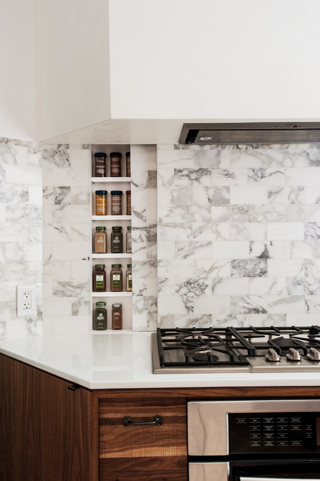 Open concept kitchen - mid-sized contemporary u-shaped open concept kitchen idea in New York with medium tone wood cabinets, multicolored backsplash, stainless steel appliances, flat-panel cabinets and marble backsplash