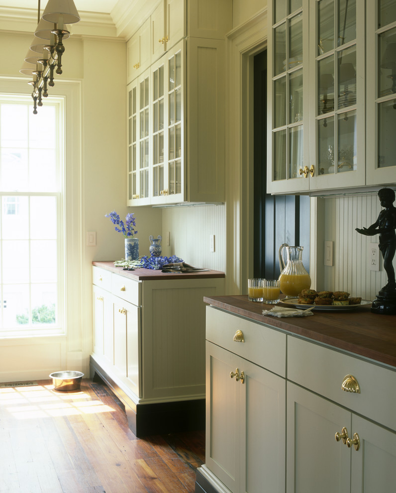 Example of a classic kitchen design in Wilmington with wood countertops and green cabinets