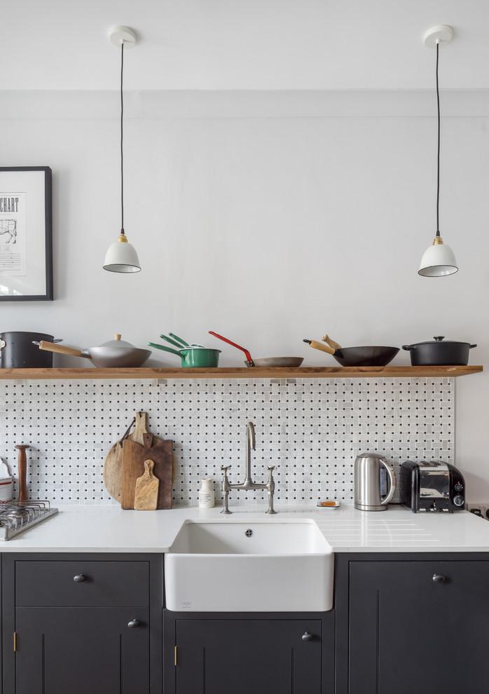Kitchen - transitional kitchen idea in London with a farmhouse sink, quartzite countertops, multicolored backsplash and open cabinets
