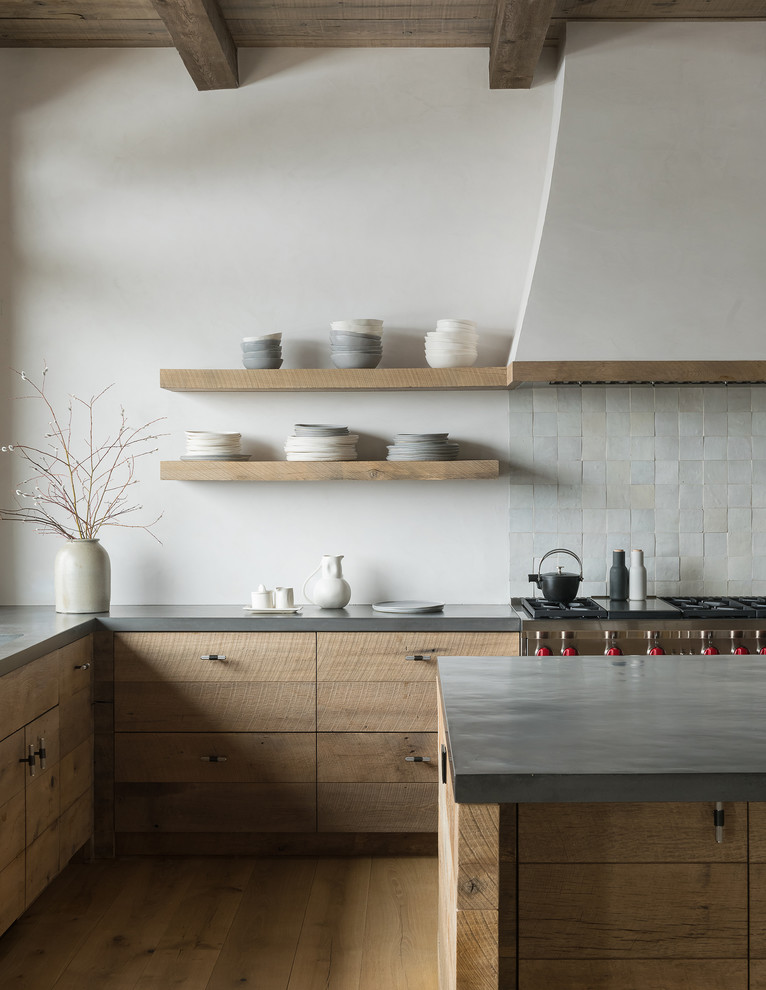 Inspiration for a rustic l-shaped light wood floor and beige floor kitchen remodel in Other with flat-panel cabinets, medium tone wood cabinets, gray backsplash, mosaic tile backsplash, stainless steel appliances, an island and gray countertops