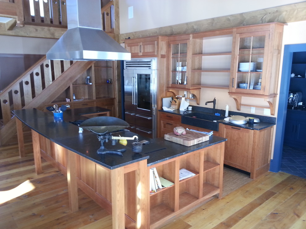 Example of a large arts and crafts u-shaped light wood floor eat-in kitchen design in Burlington with recessed-panel cabinets, marble countertops, stone slab backsplash, stainless steel appliances, an island, an undermount sink, light wood cabinets, white backsplash and white countertops