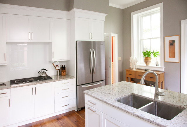 Inspiration for a timeless kitchen remodel in Charleston with a double-bowl  sink, white