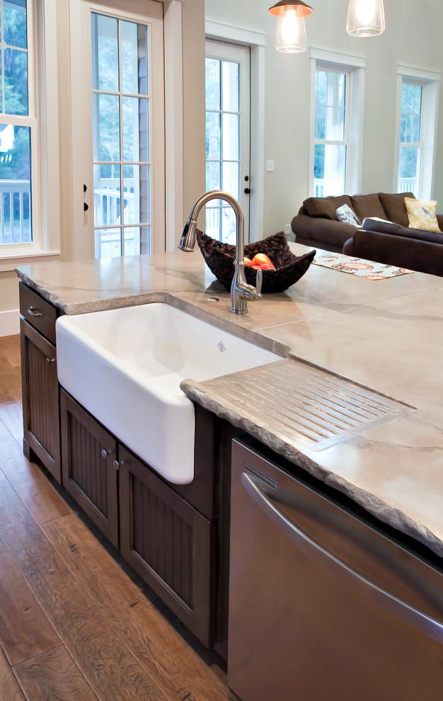 Elegant kitchen photo in Charleston with concrete countertops