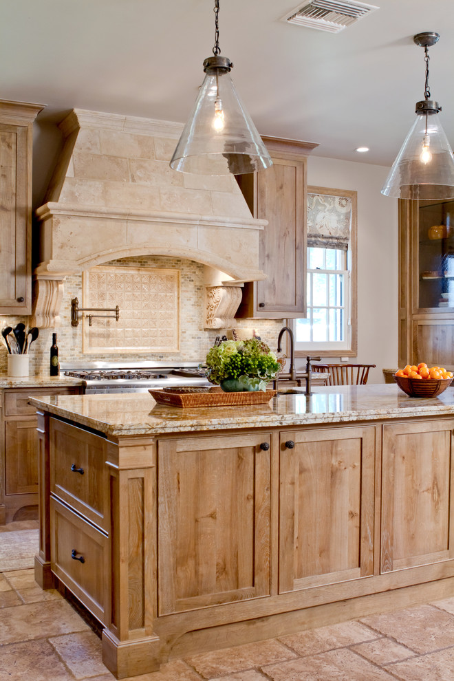 Mountain style kitchen photo in Los Angeles with granite countertops, light wood cabinets and beige backsplash