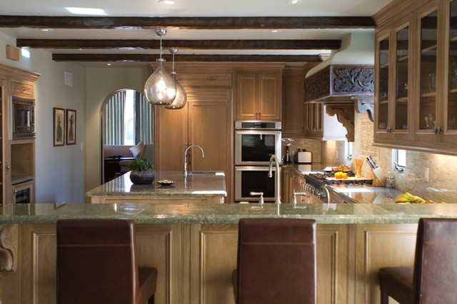 rustic kitchen by Charmean Neithart Interiors, LLC.