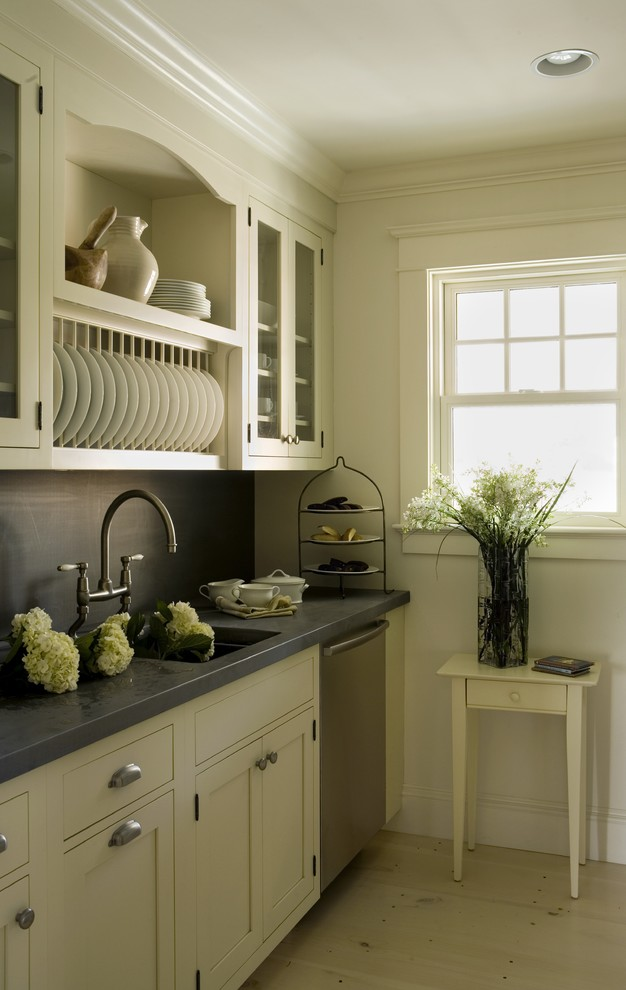 Trendy kitchen photo in Providence with glass-front cabinets