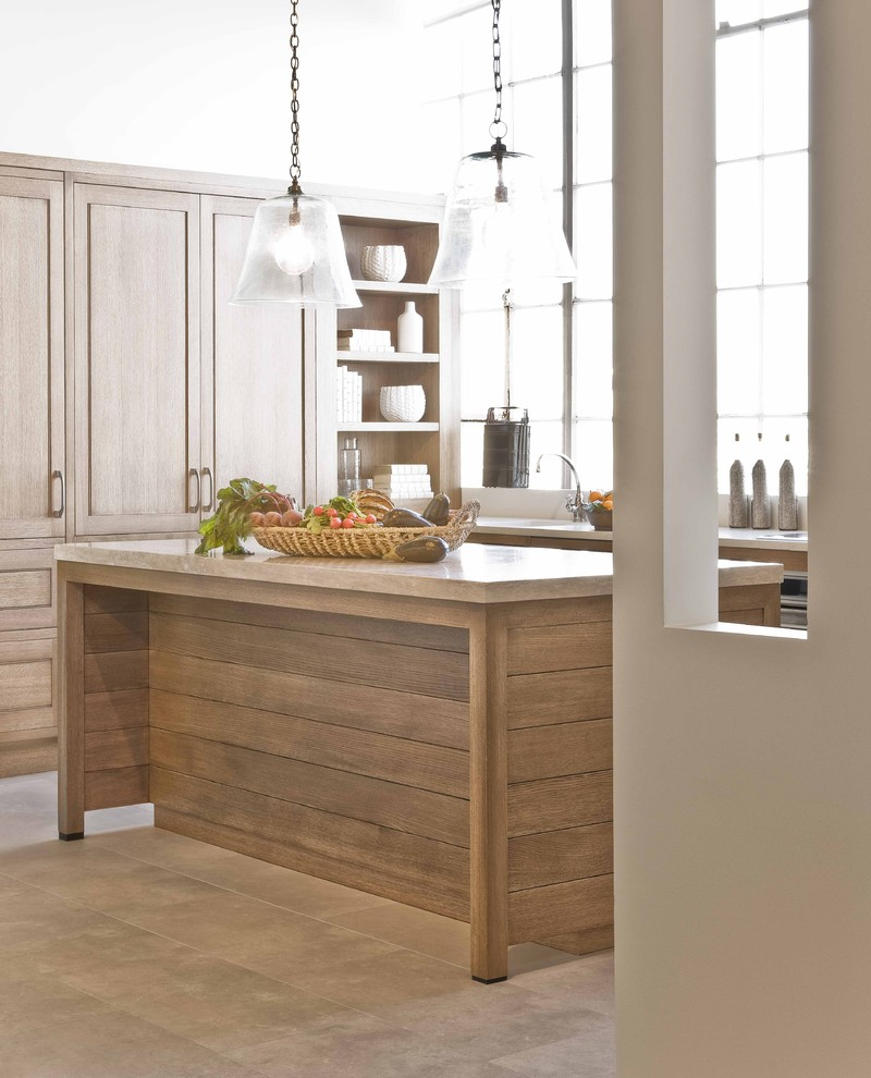 Kitchen - traditional kitchen idea in Boston with light wood cabinets and limestone countertops