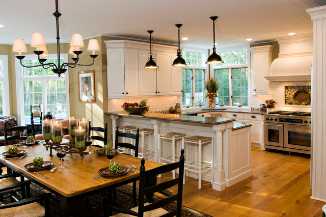 Eat-in kitchen - country u-shaped medium tone wood floor eat-in kitchen idea in New York with an undermount sink, white cabinets, granite countertops, white backsplash, subway tile backsplash, stainless steel appliances and an island