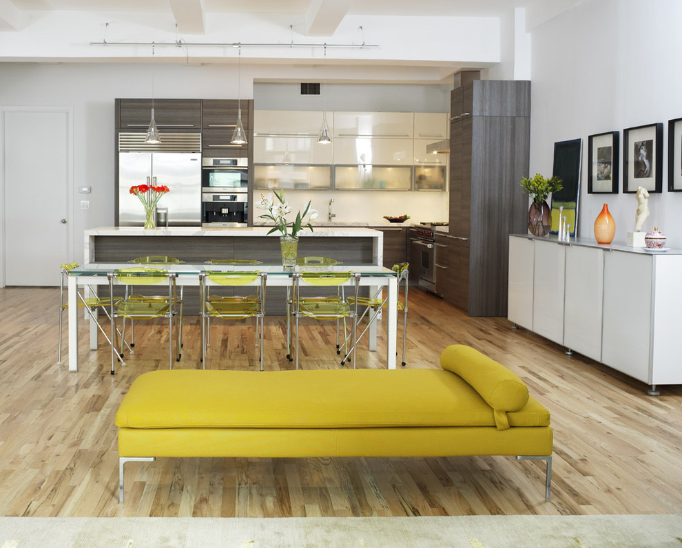Example of a trendy l-shaped eat-in kitchen design in New York with flat-panel cabinets, stainless steel appliances, gray cabinets and marble countertops