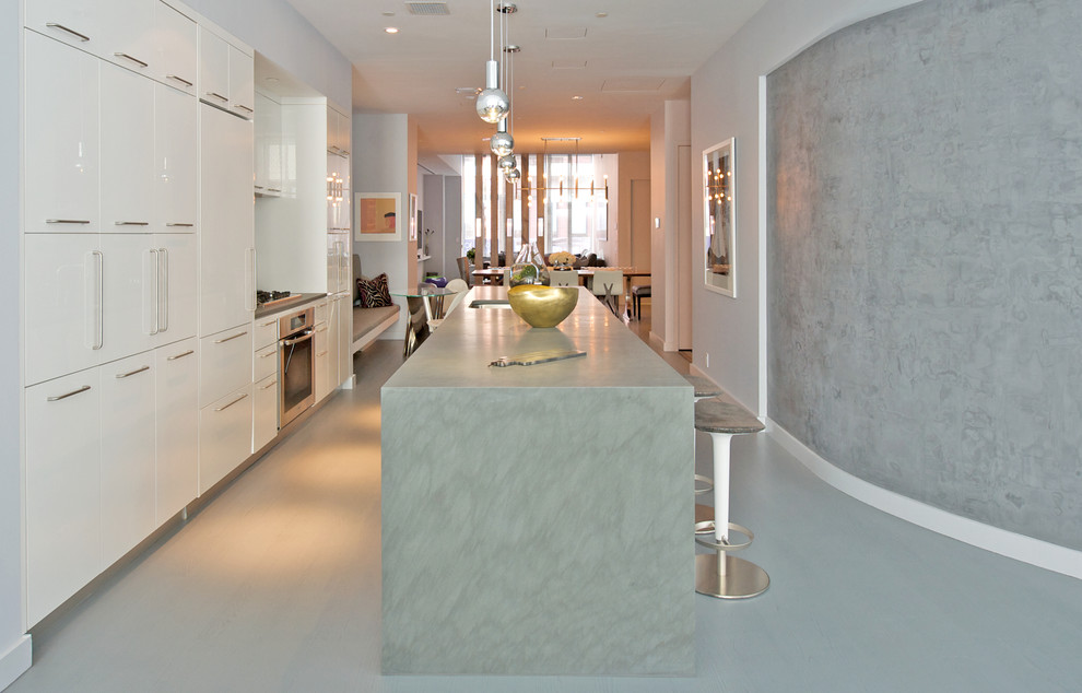 Eat-in kitchen - mid-sized contemporary u-shaped eat-in kitchen idea in New York with an undermount sink, shaker cabinets, white cabinets, stainless steel appliances, an island, mosaic tile backsplash and granite countertops