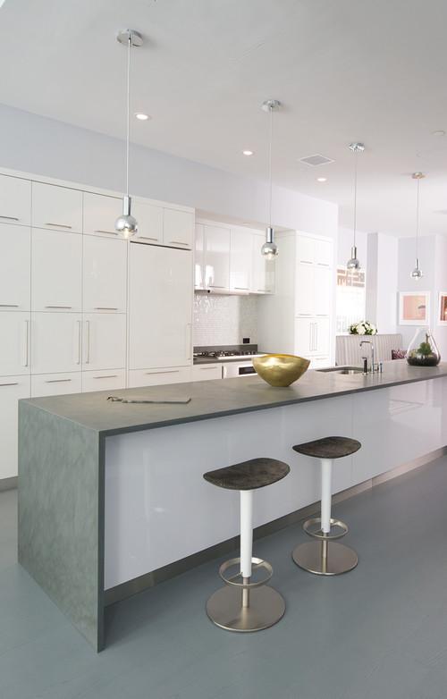 Modern kitchen featuring a waterfall countertop design