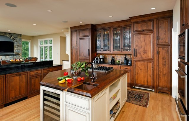 cherry and painted kitchen with glass peninsula cabinets