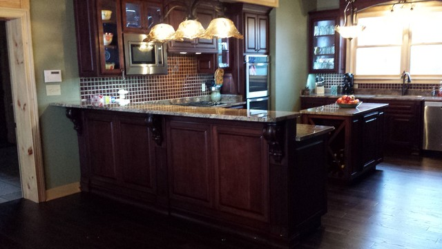 Cherry cabinets with crema bordeaux granite for Cherry bordeaux kitchen cabinets