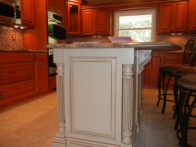 Cherry cabinets with white island