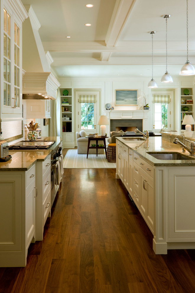 Open concept kitchen - traditional galley open concept kitchen idea in Denver with an undermount sink, beaded inset cabinets and white cabinets