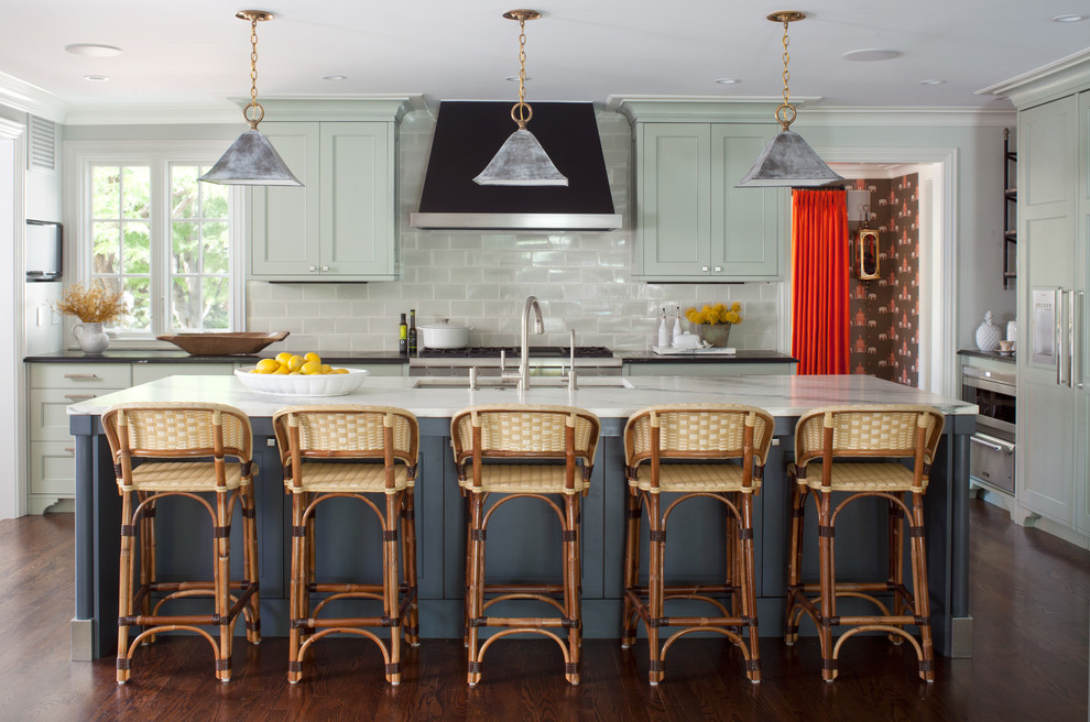 Inspiration for a transitional dark wood floor kitchen remodel in Denver with an undermount sink, shaker cabinets, gray backsplash, paneled appliances, an island and green cabinets