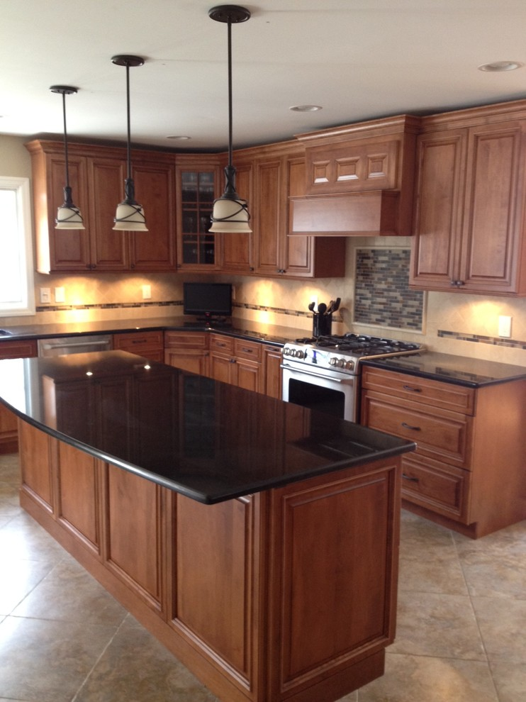 Example of a mid-sized arts and crafts l-shaped travertine floor eat-in kitchen design in Newark with an undermount sink, raised-panel cabinets, medium tone wood cabinets, quartz countertops, beige backsplash, ceramic backsplash, stainless steel appliances and an island
