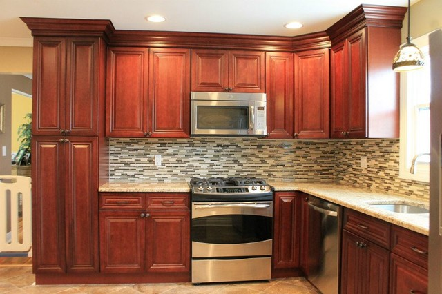cherry kitchen cabinets tile backsplash traditional kitchen - Cherry Kitchen Cabinets