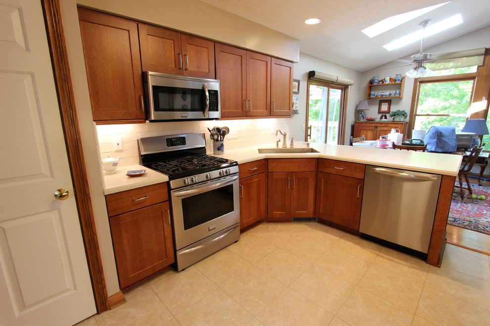 Cherry Kitchen Cabinets With Corian Countertops Broadview Heights Oh Traditional Kitchen Cleveland By Cabinet S Top Houzz