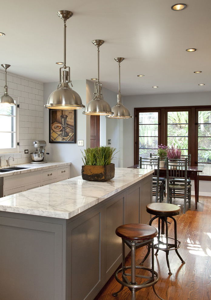 Elegant eat-in kitchen photo in Los Angeles with gray cabinets and marble countertops
