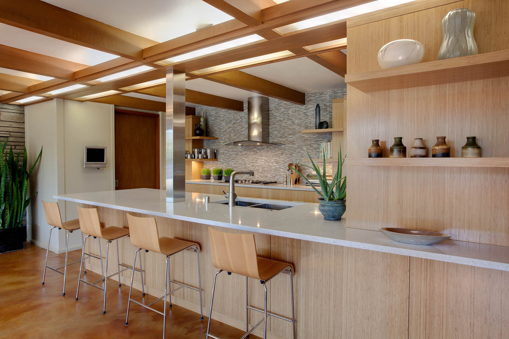 Example of a 1960s kitchen design in Milwaukee with a double-bowl sink, flat-panel cabinets, light wood cabinets and multicolored backsplash