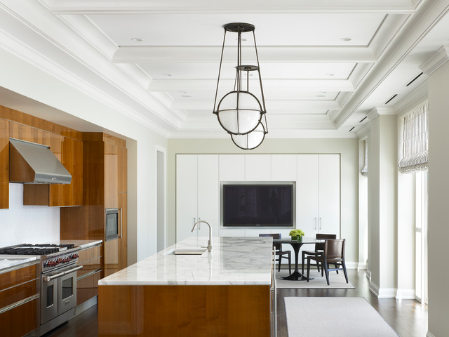 Inspiration for a large contemporary l-shaped dark wood floor eat-in kitchen remodel in Chicago with an undermount sink, flat-panel cabinets, medium tone wood cabinets, stainless steel appliances, an island, marble countertops and white backsplash