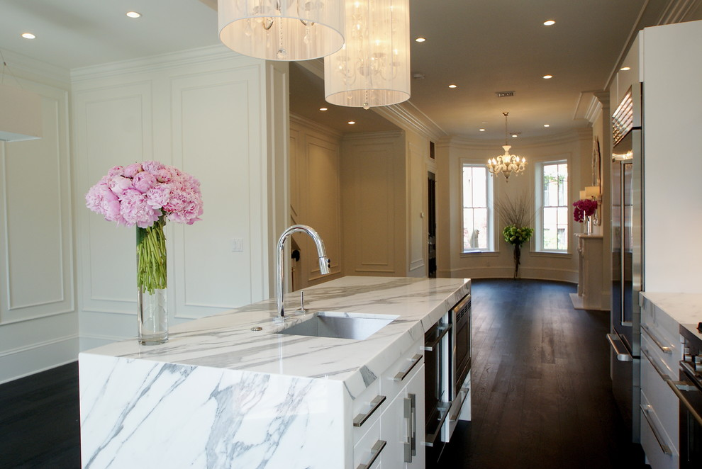 Example of a minimalist open concept kitchen design in Boston with marble countertops