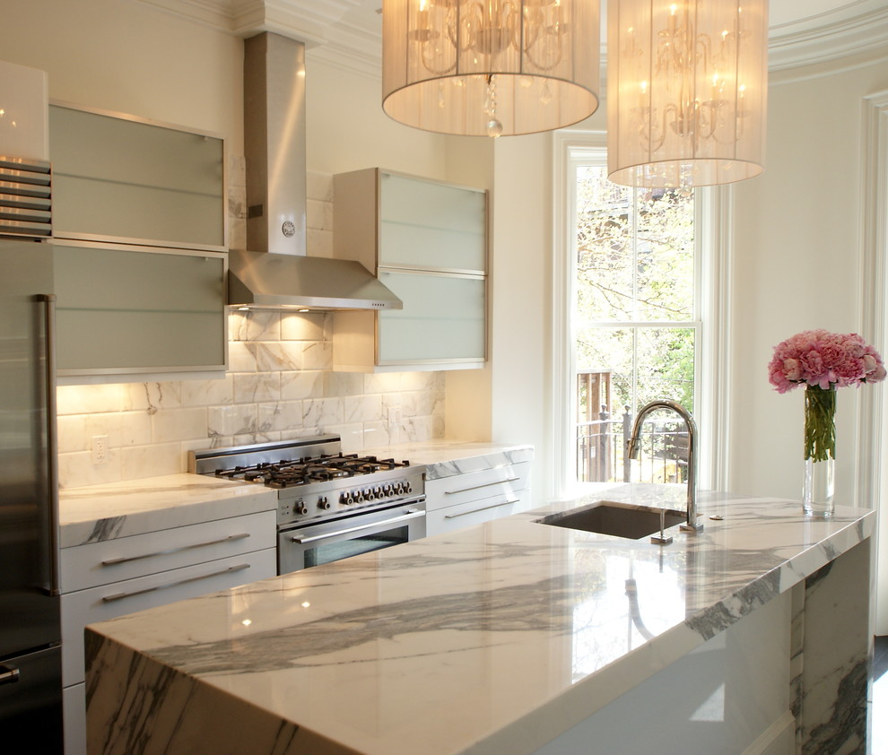 Example of a transitional kitchen design in Boston with marble countertops, a single-bowl sink, white backsplash and marble backsplash