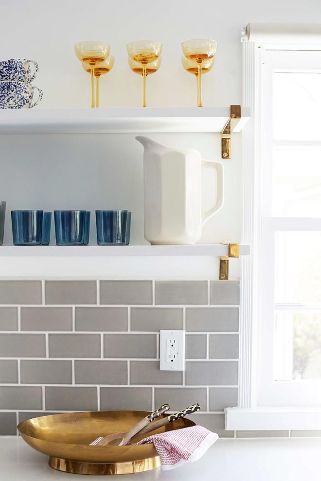 Inspiration for an eclectic cement tile floor kitchen remodel in San Francisco with blue cabinets, gray backsplash and ceramic backsplash