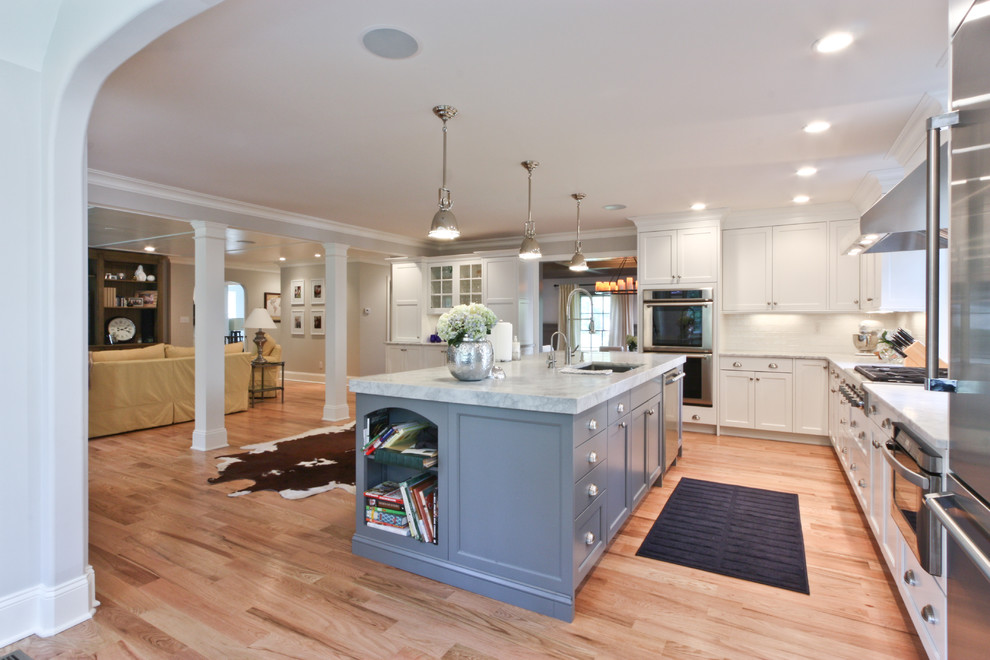Example of a classic open concept kitchen design in Newark with stainless steel appliances
