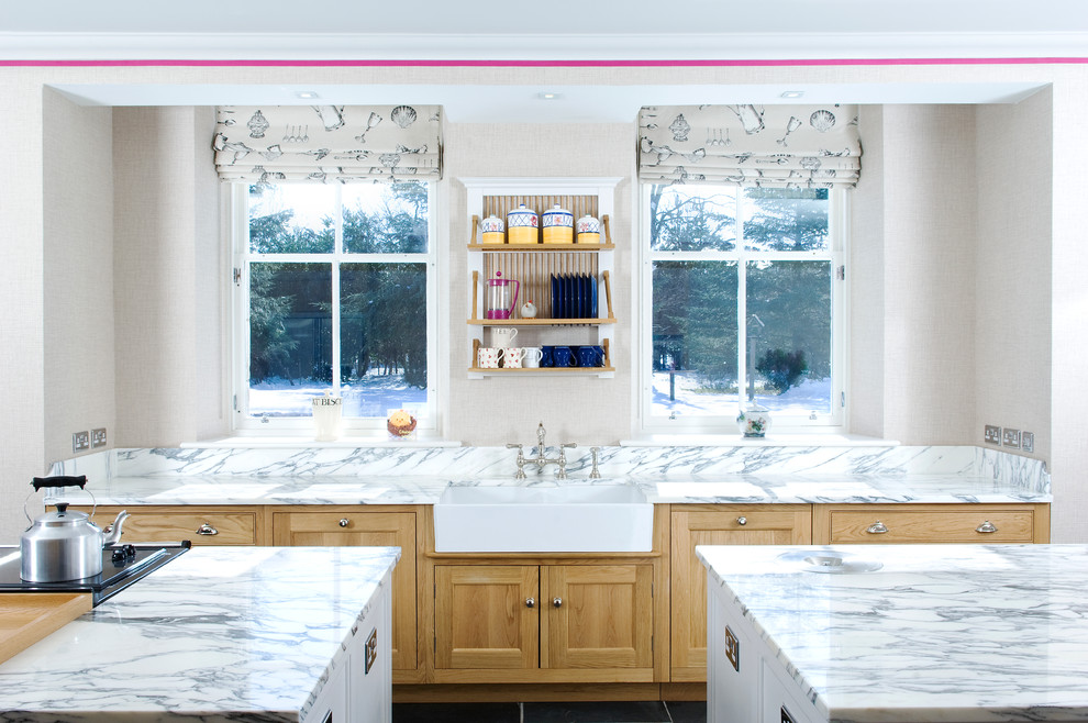 Huge elegant kitchen photo in Other with a farmhouse sink, shaker cabinets, light wood cabinets, marble countertops and two islands