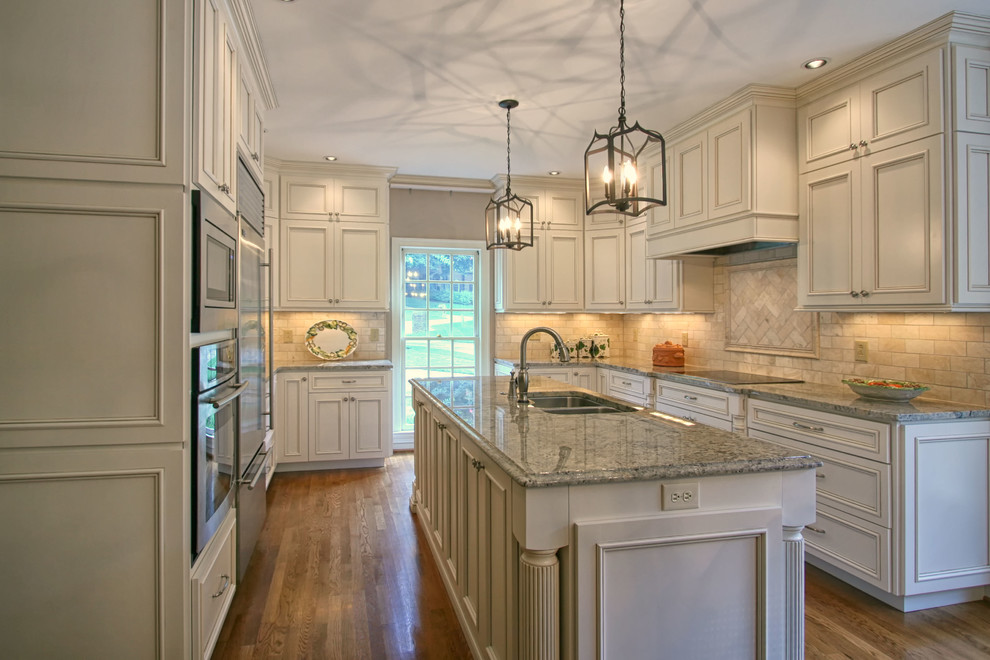 Elegant kitchen photo in Charlotte with an island