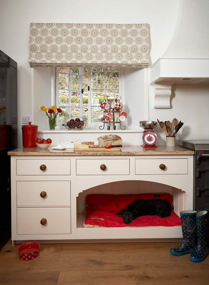Inspiration for a kitchen remodel in Devon with beige cabinets