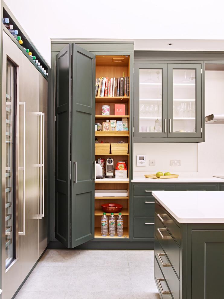 Trendy kitchen pantry photo in London
