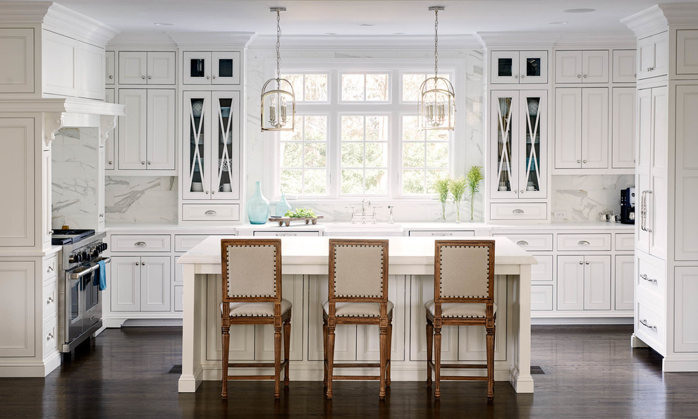 Inspiration for a timeless u-shaped kitchen remodel in Charlotte with recessed-panel cabinets, white cabinets, white backsplash, stone slab backsplash and an island