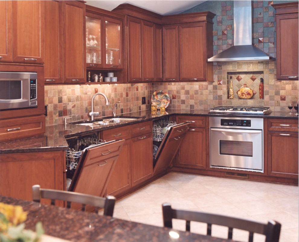 Example of a transitional kitchen design in Chicago with a triple-bowl sink, recessed-panel cabinets, granite countertops and paneled appliances