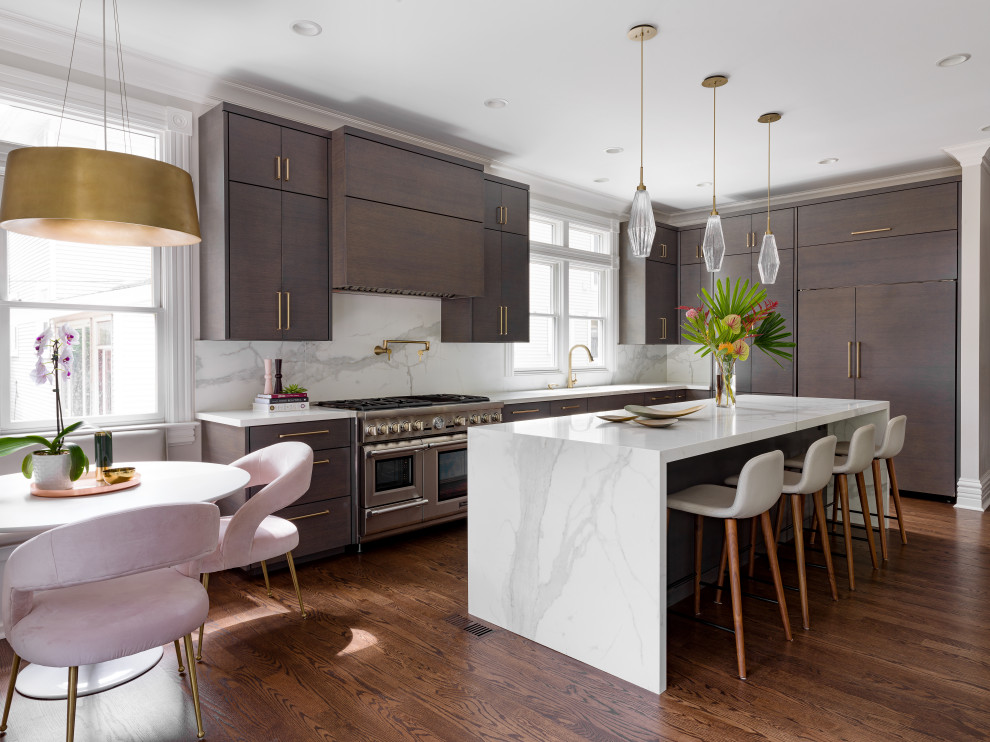 Large transitional l-shaped medium tone wood floor and brown floor eat-in kitchen photo in Chicago with an undermount sink, flat-panel cabinets, dark wood cabinets, white backsplash, marble backsplash, paneled appliances, an island and white countertops
