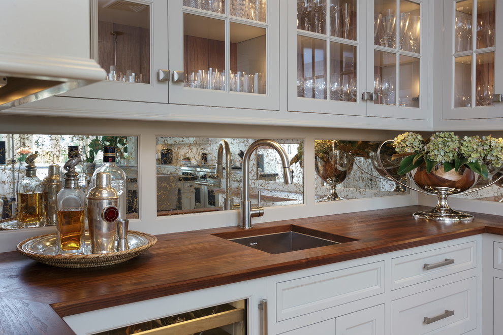 Enclosed kitchen - large traditional u-shaped light wood floor and beige floor enclosed kitchen idea in Philadelphia with an undermount sink, recessed-panel cabinets, white cabinets, marble countertops, white backsplash, marble backsplash, paneled appliances and two islands