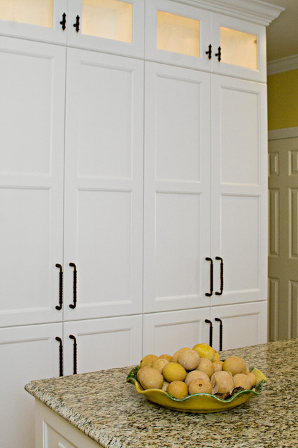 Classic White and Warm Yellow Create a Perfectly Inviting Space traditional-kitchen