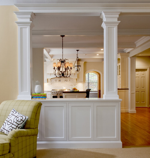 Who was ther designer of the half wall with columns i for Half wall kitchen ideas