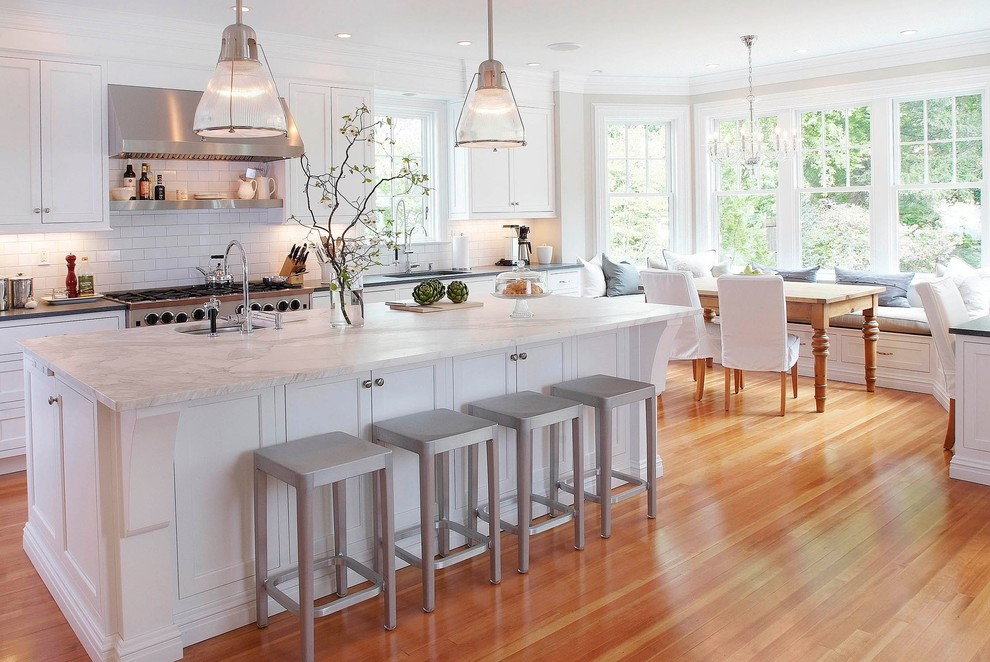 Elegant eat-in kitchen photo in New York with subway tile backsplash, marble countertops, recessed-panel cabinets, white cabinets, white backsplash and white countertops