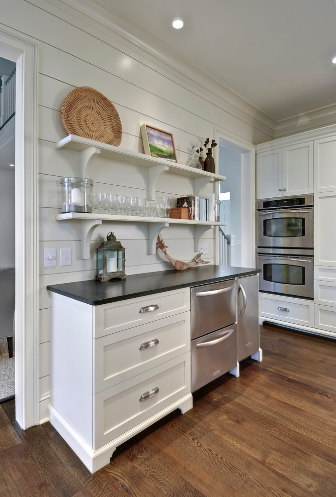 Mid-sized beach style eat-in kitchen photo in Charleston with shaker cabinets, white cabinets, stainless steel appliances and granite countertops