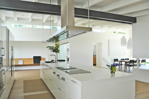 modern kitchen with a large metal ceiling joist on display
