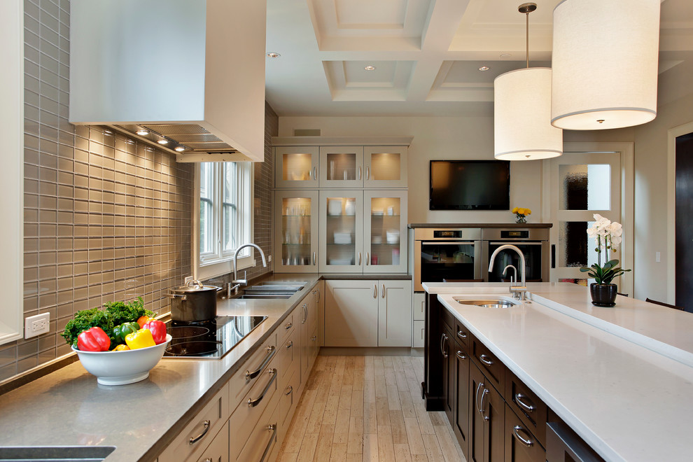 Kitchen - large transitional u-shaped kitchen idea in Chicago with an undermount sink, recessed-panel cabinets and an island