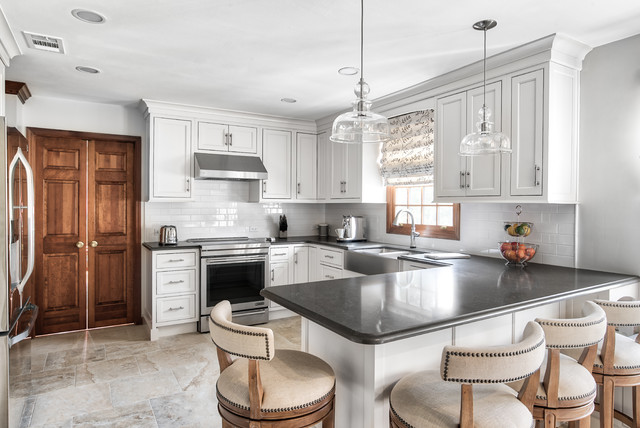 Clean White Kitchen With Black Counter