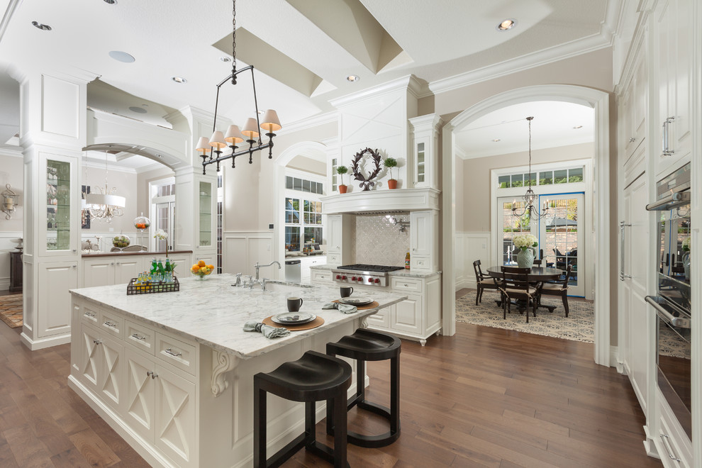 Kitchen - traditional kitchen idea in Portland with raised-panel cabinets, white cabinets and gray backsplash