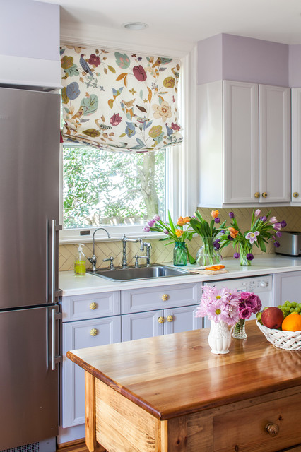 Example of a mid-sized cottage u-shaped light wood floor enclosed kitchen design in DC Metro with a single-bowl sink, recessed-panel cabinets, yellow backsplash, porcelain backsplash, stainless steel appliances and an island