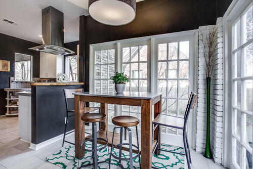 Mix and matching two different styles of stools with a rectangular pub table next to a window