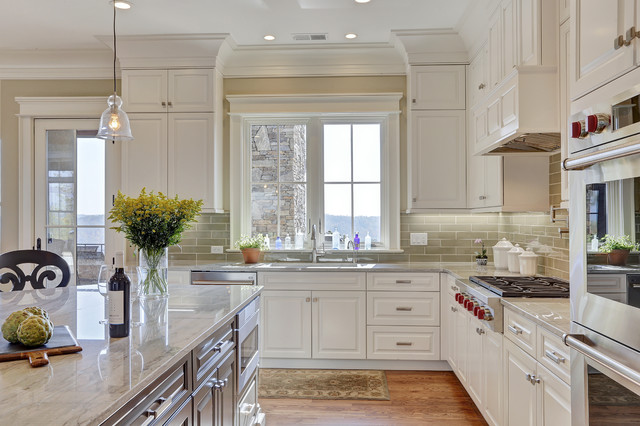 Large elegant medium tone wood floor eat-in kitchen photo in Other with an undermount sink, raised-panel cabinets, white cabinets, granite countertops, green backsplash, porcelain backsplash, stainless steel appliances and an island